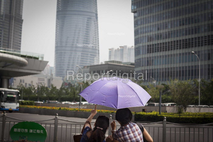 Tourists pointing at the Shanghai financial centre, Shanghai, China. - Connor Matheson - 2015-09-03