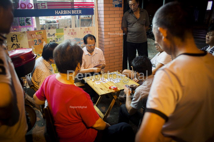 Men gambling and playing cards in the street. Shanghai, China. - Connor Matheson - 2015-09-03