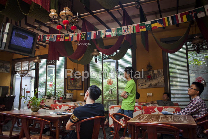 Watching the military parade commemorating victory in the Second World War on TV in a restaurant, Shanghai, China. - Connor Matheson - 2015-09-03