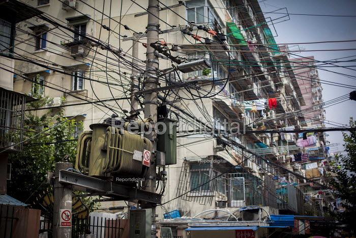 Electricity power cables and a transformer on a pole, housing, Shanghai, China. - Connor Matheson - 2015-09-03