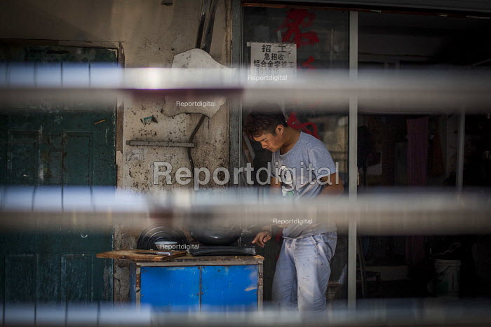A man cooking food. Shanghai, China. - Connor Matheson - 2015-09-03