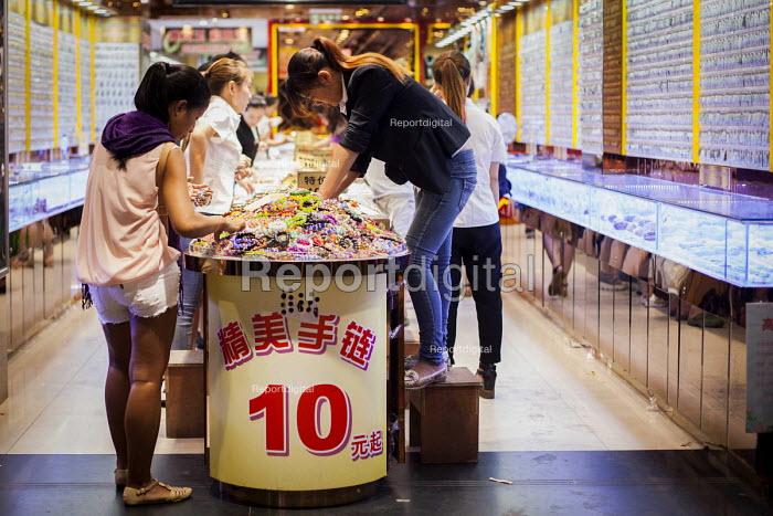Tourists buying gifts inside a Ten Yuan Store. Shanghai, China. - Connor Matheson - 2015-09-05