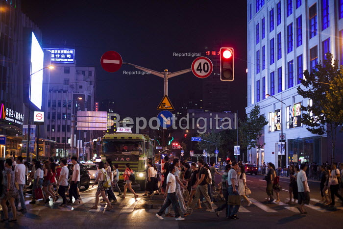 Busy city, tourists crossing Nanjing Road, Shanghai, China. - Connor Matheson - 2015-09-05