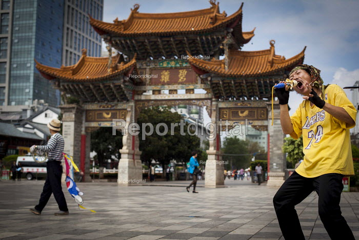 Miming to western pop songs by the Traditional Chinese Gates. Kunming, Yunnan Province, China. - Connor Matheson - 2015-09-10