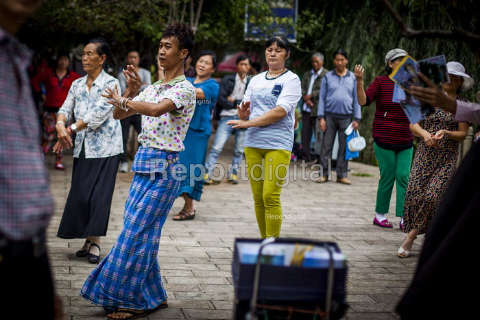 Square dancers, dancing in Cuihu Park, Kunming, Yunnan Province, China. - Connor Matheson - 2015-09-10