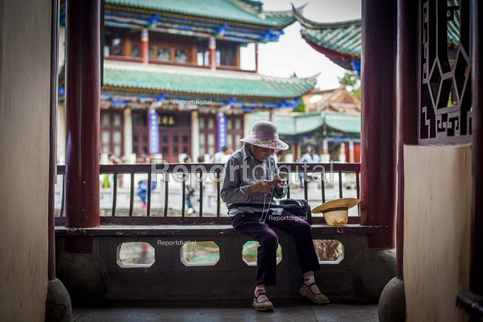 An elderly woman embroidering, Cuihu Park, Kunming, Yunnan Province, China. - Connor Matheson - 2015-09-10