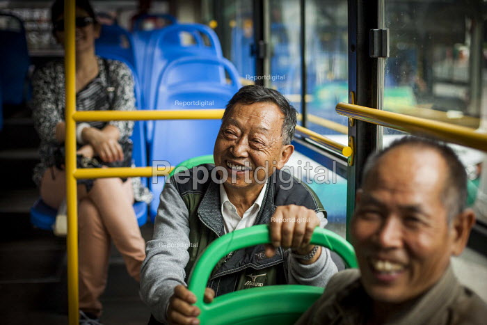 A Elderly man travels on the bus. Kunming, Yunnan Province, China. - Connor Matheson - 2015-09-10