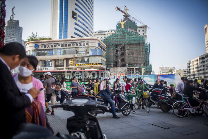 Locals riding scooters, new Cathedral of the Sacred Heart of Jesus being built, Kunming, Yunnan Province, China. - Connor Matheson - 2015-09-10