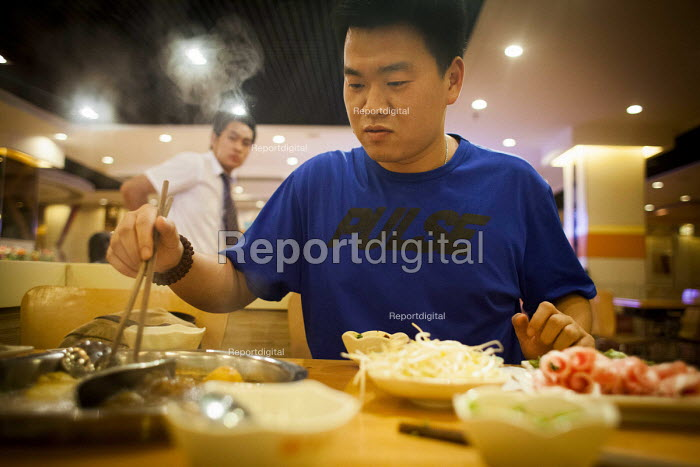locals eating in a restaurant, Kunming, Yunnan Province, China. - Connor Matheson - 2015-09-11