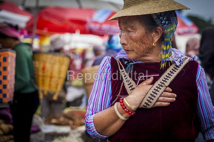 An elderly woman shopping, Dali, Yunnan Province, China. - Connor Matheson - 2015-09-18