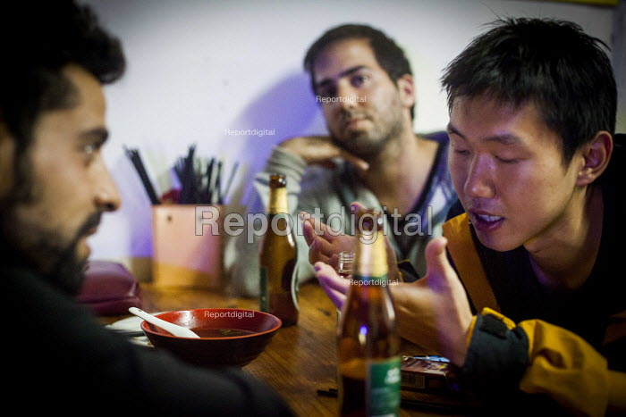 A Chinese local arguing with some Israeli tourists after a night of drinking. Dali, China. - Connor Matheson - 2015-09-19