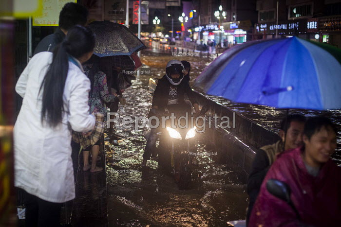 A motorcycle, flooding after heavy rain. Lijiang, Yunnan Province, China. - Connor Matheson - 2015-09-22