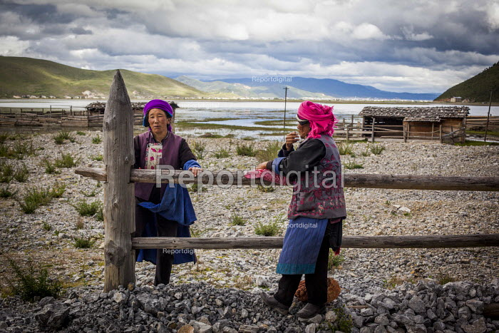 Elderly Bai woman talking to each other in their farm, Shangri-La, Yunnan Province, China - Connor Matheson - 2015-09-24