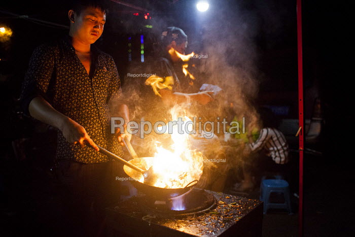 A worker cooking street food. Kunming, Yunnan Province, China. - Connor Matheson - 2015-09-26