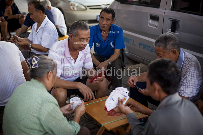 Locals playing cards and gambling. Dongcheng, Yunnan Province, China. - Connor Matheson - 2015-09-28