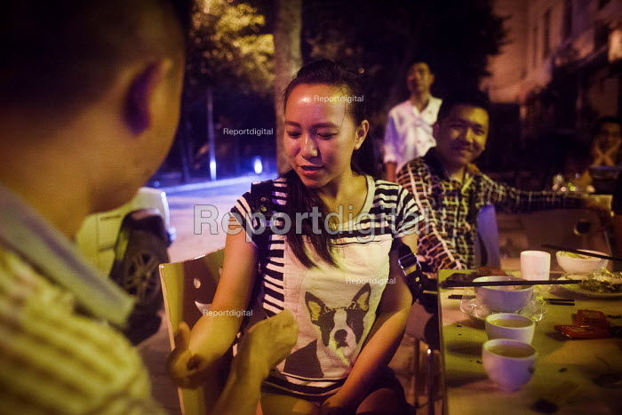 Chinese drinkers playing finger guessing drinking game at a bar. Dongcheng, Yunnan Province, China. - Connor Matheson - 2015-09-28