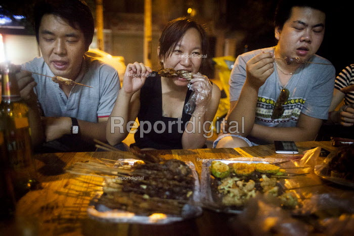 Young people eating street food. Dongchuan, Yunnan Province, China. - Connor Matheson - 2015-09-29