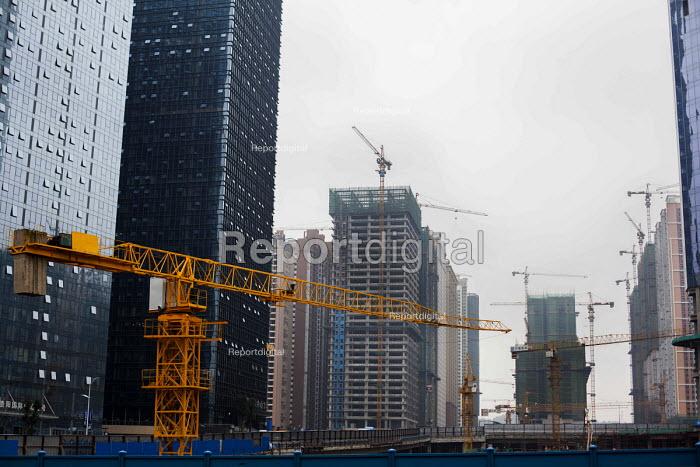 Cranes building new housing. Guiyang,Yunnan Province, China. - Connor Matheson - 2015-10-03