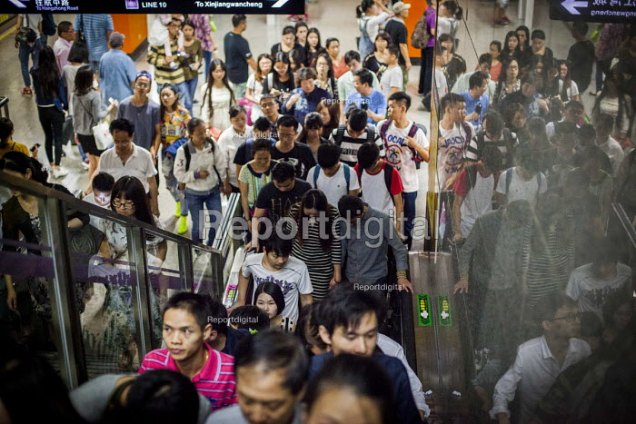 Busy crowds on the subway system. Shanghai, China. - Connor Matheson - 2015-10-04