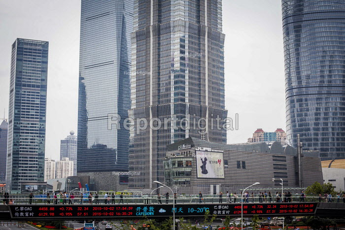 Shanghai Stock Exchange prices displayed on a bridge, Lujiazui Financial District, Pudong, Shanghai, China. - Connor Matheson - 2015-10-05