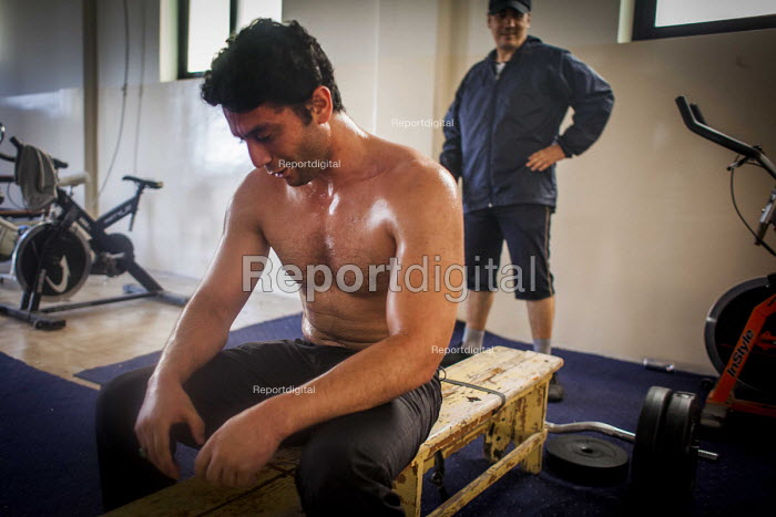 Syrian refugee weight lifting in the communal gym, Marsa Open Centre, Malta. - Connor Matheson - 2015-07-14