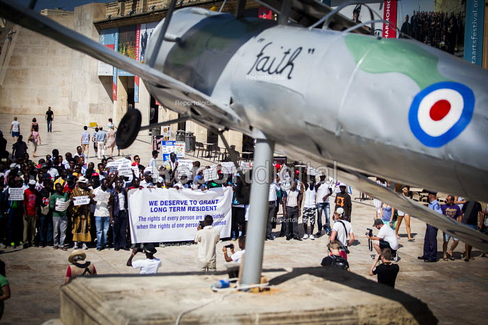 Refugees protest for an integration policy as it is impossible for refugees to become full citizens. Valletta, Malta. Protest is by Faith, Sea Gladiator of the RAF Hal Far Fighter Flight - Connor Matheson - 2015-07-19