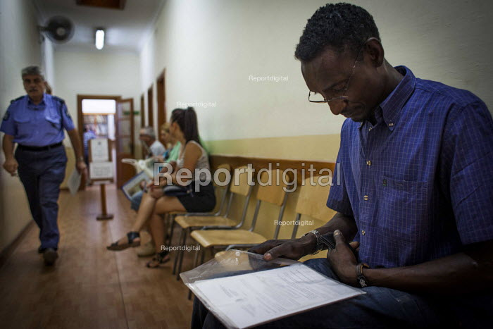 Malta, Mahjoub a Sudanese refugee at Valletta Police Station waiting to obtain his police record, a clear one is required to gain a new Work Permit, Valletta, Malta. - Connor Matheson - 2015-07-20