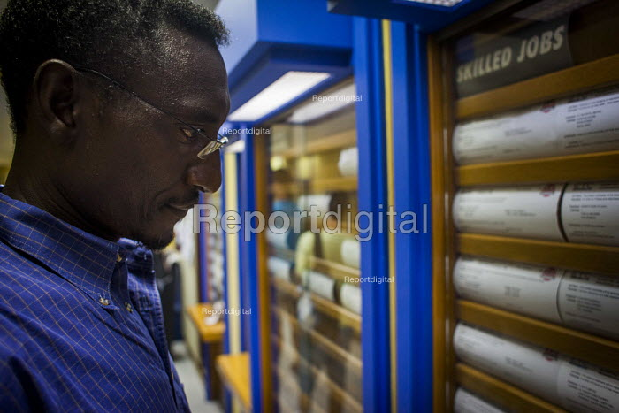 Malta, Mahjoub a Sudanese refugee looking for skilled work in the Job Centre. Valletta, Malta. - Connor Matheson - 2015-07-20