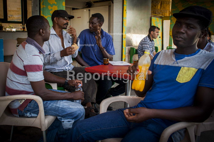 Malta, Mahjoub a Sudanese refugee talking with his friends at a coffee shop Valletta, Malta. - Connor Matheson - 2015-07-20