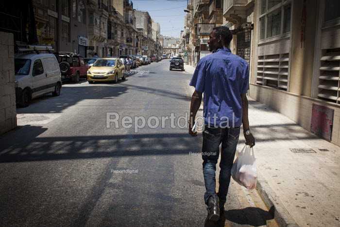 Malta, Mahjoub, a Sudanese refugee taking fruit to his friends house. Valletta, Malta. - Connor Matheson - 2015-07-20
