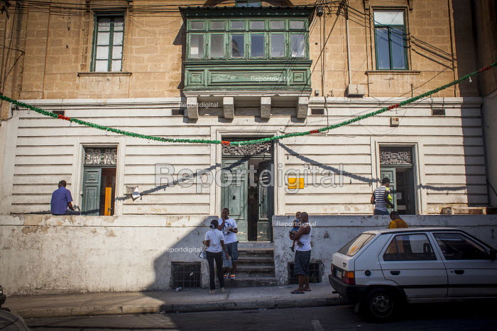 Refugees waiting outside the Refugee Commission to renew their work permits. Msida, Malta - Connor Matheson - 2015-07-20