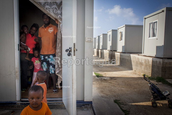 Nigerian family of 6 living in a small cabin. Hal Far Refugee Camp, Malta. - Connor Matheson - 2015-08-10