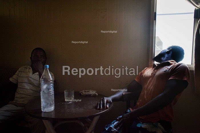 A Nigerian family of 6 living in a small cabin. Hal Far Refugee Camp, Malta. - Connor Matheson - 2015-08-10