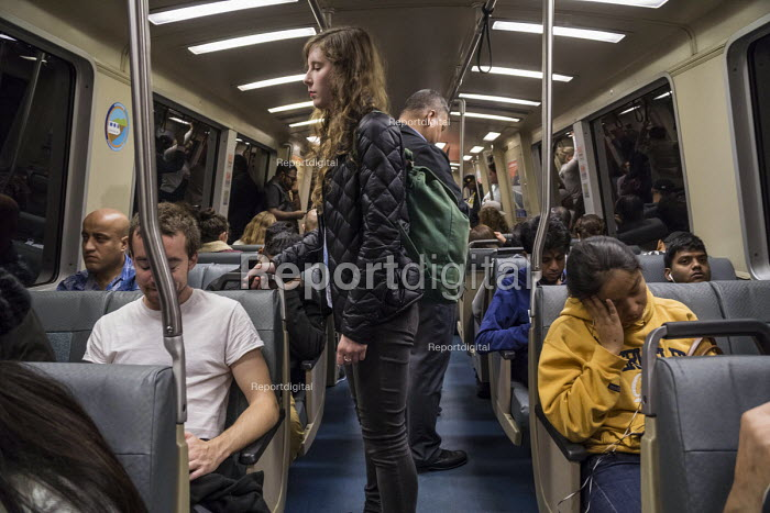 San Francisco, Passengers on the Bay Area Rapid Transit system - David Bacon - 2015-11-21