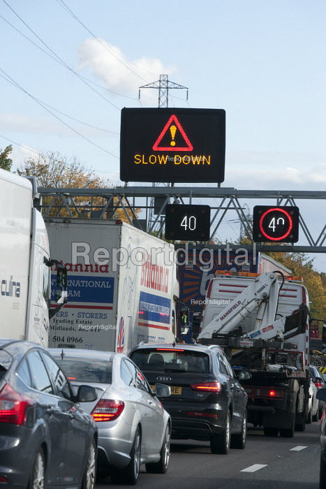 Traffic congestion M6 Motorway tempory speed limit, slow down sign, Staffordshire - John Harris - 2015-10-30