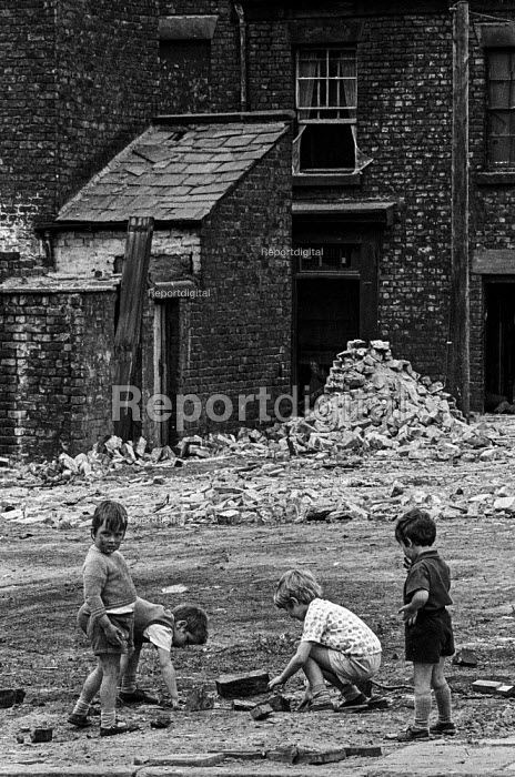 Slum clearance, Liverpool. Children playing in rubble of terraced houses demolished to make way for high rise tower blocks - Martin Mayer - 1970-07-10