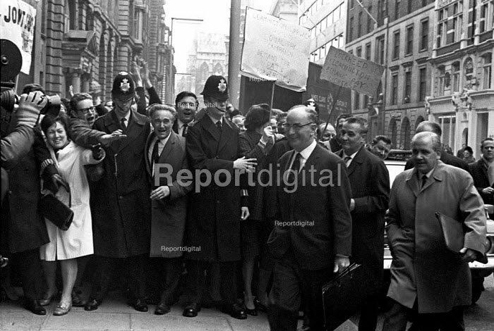 AEU lobby of the annual engineering pay talks, Tothill Street, London. Hugh Scanlon (carrying briefcase), leader of the AEU and other union leaders walk past the lobby, April 1968 - NLA - 1968-04-10