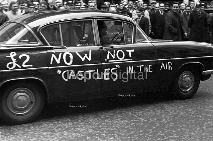 2 a week now not Castles in the Air, slogan on a car in reference to Barbara Castle and In Place of Strife an attempt to transform industrial relations with new legislation. AEU lobby the annual engineering pay talks, Tothill Street, London April 1968 - NLA - 1968-04-10