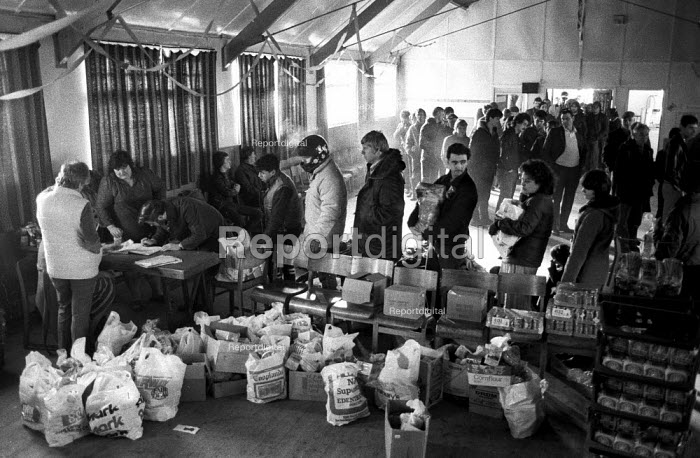 Food parcels for single men, Including Christmas chickens, been distributed from Rossington miners welfare, Doncaster. Food parcels at Christmas time from donations, made up by the Womens Support Committee and given to single men on strike who would otherwise get nothing. - John Harris - 1984-12-21