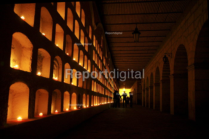 On the Day of the Dead, Oaxacans light candles in the grave wall niches in the citys main cemetery. - David Bacon - 2008-10-30