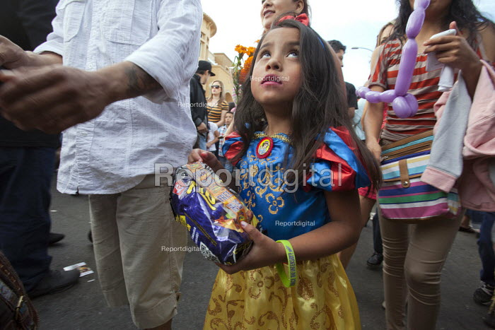 Oakland, California: Girl with a present. Mexican festival of the Day of the Dead in Oakland's Latino Fruitvale District. - David Bacon - 2013-11-02