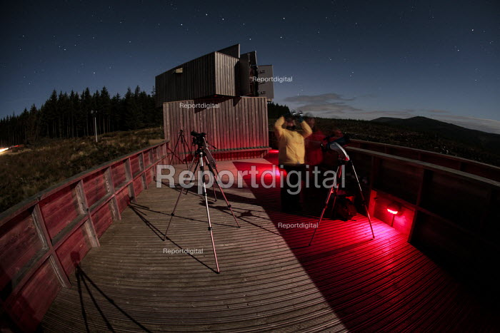 Visitors to the The Kielder Observatory view the Cosmos through binoculars on the viewing platform of the Observatory, Kielder, Northumberland. - Mark Pinder - 2010-09-25