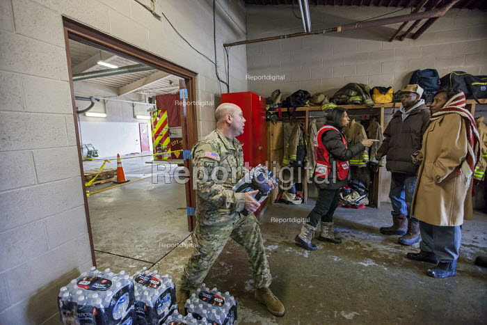 Flint, Michigan, Residents pick up clean bottled water and water filters from Red Cross disaster relief volunteers, Fire Station #6. Water and filters were distributed after cost cutting by state officials led to high lead levels in the city water supply - Jim West - 2016-01-13
