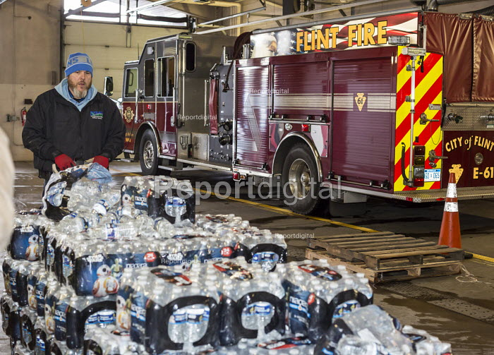 Flint, Michigan, clean Bottled water is delivered to Fire Station #6 for residents to collect. Water and water filters were distributed after cost-cutting by state officials led to high lead levels in the city water supply - Jim West - 2016-01-13