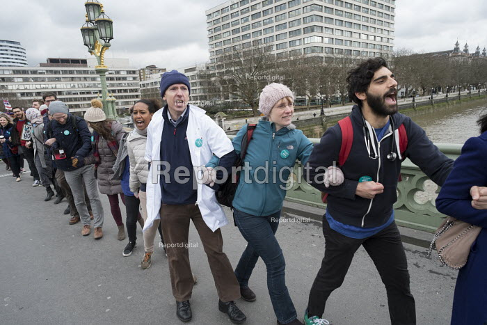 Junior doctors strike over a proposed new contract cross Westminster Bridge to protest outside the Houses of Parliament. - Philip Wolmuth - 2016-02-10