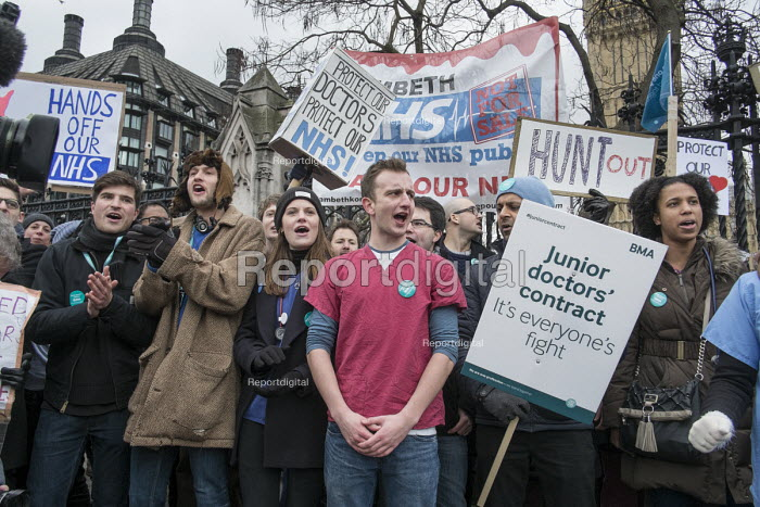 Junior doctors strike over proposed new contract cross Westminster Bridge to protest outside the Houses of Parliament. - Philip Wolmuth - 2016-02-10