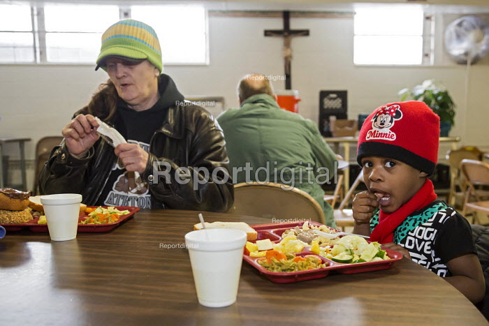 Flint, Michigan, young girl eating, North End Soup Kitchen. The soup kitchen is operated by Catholic Charities - Jim West - 2016-02-18