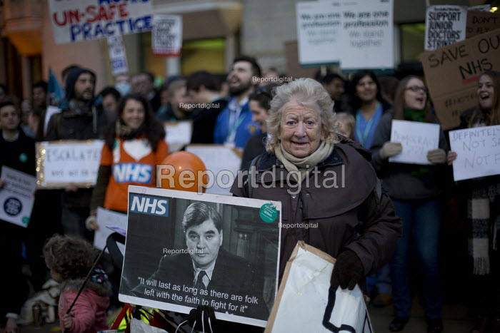 June Hautot with a picture of Nye Bevan quote: It will last as long as their are folk left with the faith to fight for it. BMA junior doctors protest outside the Department of Health against the imposition of a new contract. Whitehall, London - Jess Hurd - 2016-02-12
