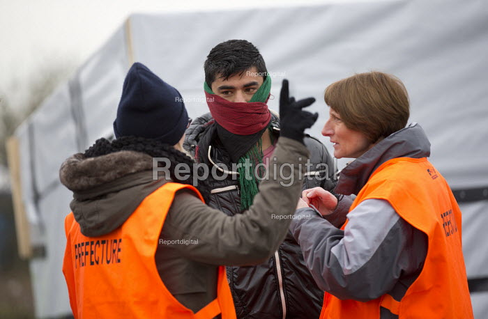 The Prefecture tell refugees to leave the makeshift Jungle camp prior to a demolition planned by French authorities. Calais, France. - Jess Hurd - 2016-02-26