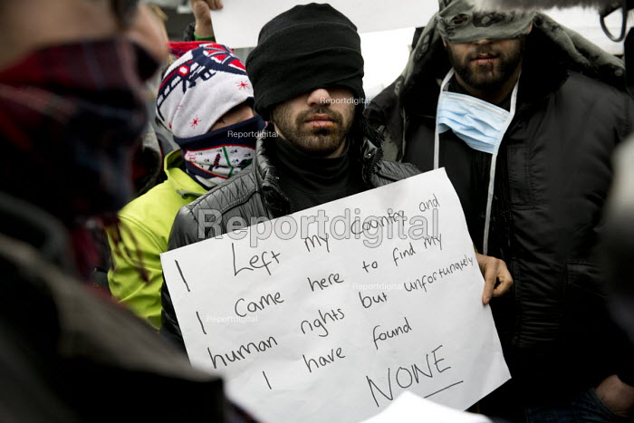 Iranian asylum seekers with stitched up mouths in protest at not beening heard by French authorities demolishing the makeshift Jungle refugee camp. Calais, France. - Jess Hurd - 2016-03-02